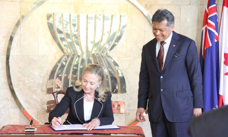 U.S. Secretary of State Hillary Clinton signs the guest book upon arriving at the ASEAN Secretariat in Jakarta.
